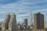 NEW YORK A view from river with Empire state building and Helicopter Royalty Free Stock Photography