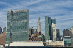 NEW YORK view from river with United Nation and chrysler tower. On cloudy sky background royalty free stock photography
