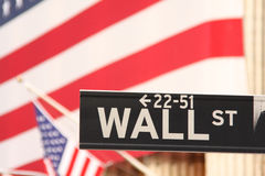 New York,Wall Street plate. Plate Wall street with the american flag of the Stock Exchange as background Stock Photography