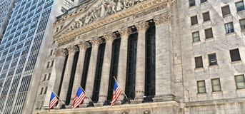 New York, Wall Street stock exchange with classic columns and old architecture and colorful flags of united states of. New York, 20 may 2016. Wall Street stock stock photo