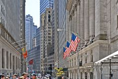 New York, Wall Street Stock Exchange With Classic Columns And Old Architecture And Colorful Flags Of United States Of Royalty Free Stock Photography