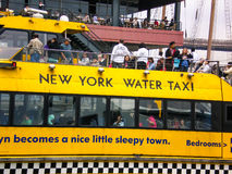 New York Water Taxi. Travellers riding the New York Water Taxi Royalty Free Stock Photos