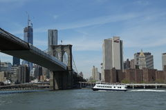 New York Waterway ferry under Brooklyn Bridge Royalty Free Stock Images