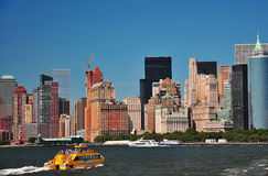 New york waterways. Downtown manhattan shot with water taxi Stock Images