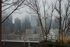 New York - winter foggy rooftop view of city and T Stock Image