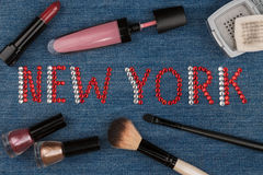 New York. World capitals of fashion. Word inlaid rhinestones and cosmetics. View from above Royalty Free Stock Images
