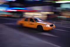 New York yellow cab driving through Times Square Royalty Free Stock Photo