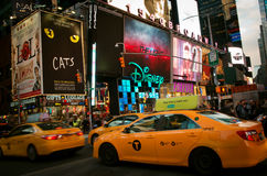 New York yellow cabs going through Time Square. Royalty Free Stock Photography