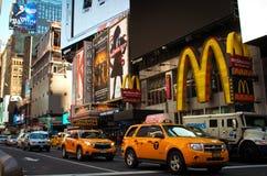 New York yellow cabs going through Time Square. Stock Photos
