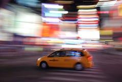 New York yellow taxi speeding through Times Square stock image
