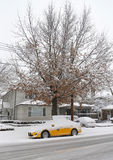New York Yellow taxi under snow in Brooklyn, NY during massive Winter Storm Thor Royalty Free Stock Images