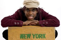 New Yorker. Hip young black woman leaning on a box that says New York Stock Photos