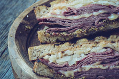New Yorker Sandwich with Instagram Style Filter on rustic wood b Stock Photos