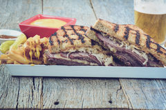 New Yorker Sandwich with Instagram Style Filter on rustic wood b Stock Photography