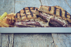 New Yorker Sandwich with Instagram Style Filter on rustic wood b Royalty Free Stock Image