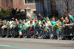 New Yorkers wait for the St. Patrick's Day Parade. Crowds of green clad New Yorkers wait for the Saint Patrick's Day Parade Royalty Free Stock Photography