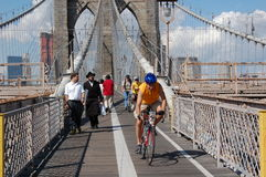 New Yorkers walk on the Brooklyn Bridge Royalty Free Stock Image