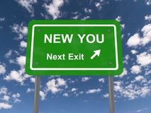 New you, next exit. Green highway sign with text new you, next exit with directional arrow against blue sky with clouds Royalty Free Stock Photos