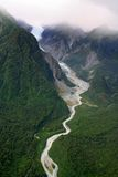 New Zealand. Fox Glacier in New Zealand surrounded by mountains taken from helicopter Stock Photography