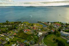 New Zealand, Aerial of Rotorua lakeside in early morning royalty free stock images