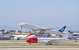 New Zealand Airlines Boeing 777 Departing Los Angeles. LOS ANGELES/CALIFORNIA - AUG. 9, 2015:New Zealand Airlines Boeing 777 takes off as Norwegian Airlines stock image