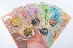 New Zealand banknotes and coins set in white background Stock Photo