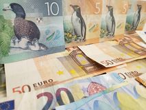 New Zealand banknotes and euro bills. European, nzd, dollar, dollars, commerce, exchange, travel, trade, trading, value, buy, seamless, sell, profit, price royalty free stock photo