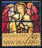 Stained Glass Window Depicting Angel with Trumpet. NEW ZEALAND - CIRCA 1995: stamp printed by New Zealand, shows Stained Glass Window Depicting Angel with stock photo