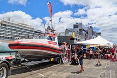 A New Zealand coastguard rescue vessel. A coastguard rescue vessel rests on a boat trailer on Captain Cook wharf, Auckland, New Zealand, during the port`s open stock image