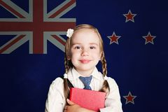 New Zealand concept with child girl student with book against the New Zealand flag background stock images