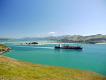 New Zealand: container ship Otago Harbour Royalty Free Stock Photography