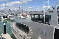 New Zealand customs services boat mooring in Westhaven Marina. New Zealand customs boat mooring in Westhaven Marina against Auckland skyline.It provide border Stock Photos