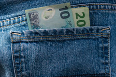 New Zealand dollars in jeans Royalty Free Stock Photography