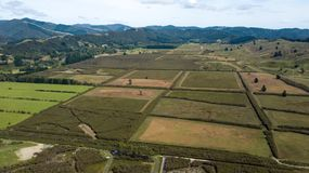 New Zealand Farmlands In Hutt Valley Aerial. Beautiful Upper Hutt farmlands in between mountains Royalty Free Stock Photos