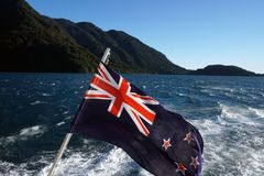 New Zealand flad at Milford Sound Stock Images