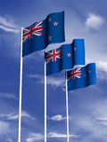 New Zealand Flag. The flag of New Zealand flying under a blue sky stock illustration