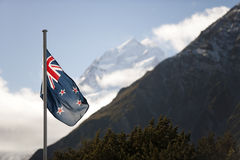 New Zealand Flag and Aoraki/Mount Cook. National flag of New Zealand set against the countrys highest mountain (3754 metres royalty free stock images