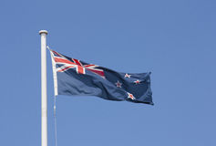 New Zealand Flag. Blowing in the wind aginst a blue sky Stock Images