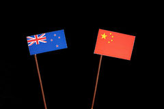New Zealand flag with Chinese flag on black. Background royalty free stock images