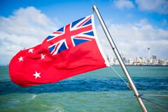New Zealand Flag flying off ferry boat at an Island of Auckland, New Zealand stock photos