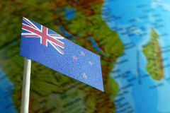 New Zealand flag with a globe map as a background Stock Photos