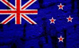 New Zealand Flag On Grunge Wall Background Royalty Free Stock Photo