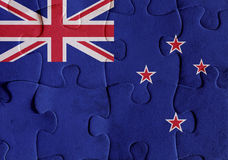 New Zealand flag puzzle. Illustration of a flag of New Zealand over some puzzle pieces. Its a JPG image Royalty Free Stock Images