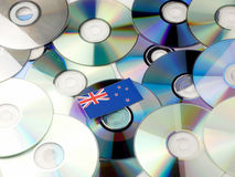 New Zealand flag on top of CD and DVD pile isolated on white. New Zealand flag on top of CD and DVD pile isolated Stock Images