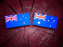 Free New Zealand Flag With Australian Flag On A Tree Stump Stock Photo - 97950500