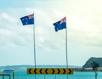 New Zealand flags by the sea side royalty free stock image