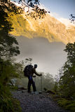 New Zealand Hiking. A hiker pauses for a rest at a clearing while ascending into the mountains Stock Image
