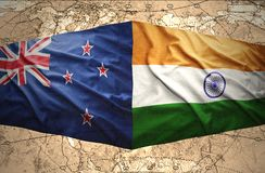 New Zealand and India. Waving New Zealand and Indian flags of the political map of the world Stock Images