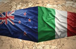 New Zealand and Italy. Waving New Zealand and Italian flags of the political map of the world Royalty Free Stock Photo