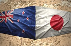 New Zealand and Japan. Waving New Zealand and Japanese flags of the political map of the world Royalty Free Stock Images